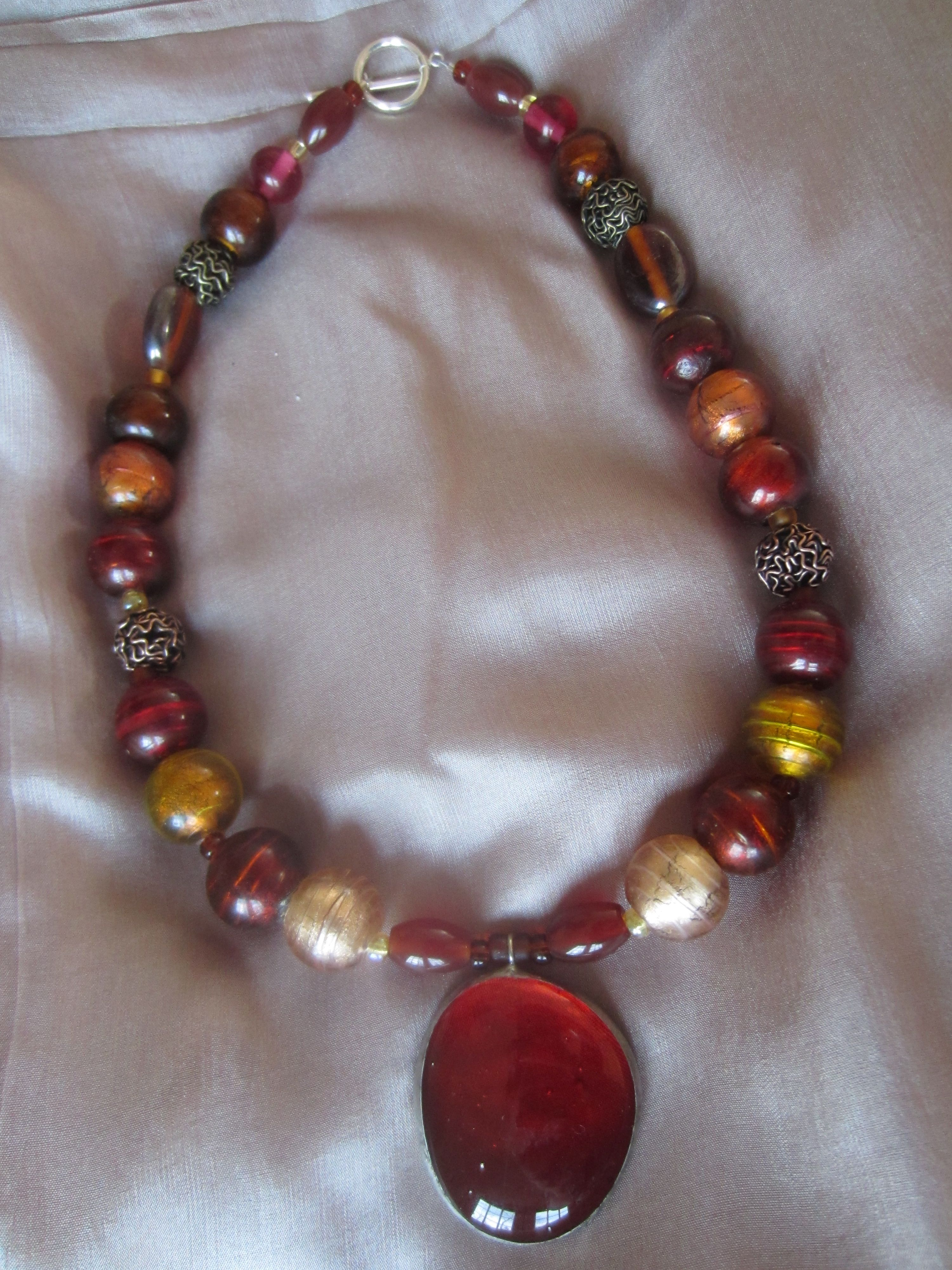 rust and gold glass bead handcrafted necklace with pendant